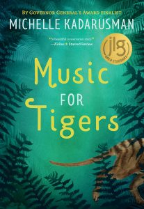 A brown, dog-like animal with stripes along its back walks off the page behind a canopy of eucalypts. Cover: Music for Tigers: Author: Michelle Kadarusman Publisher: Pajama Press